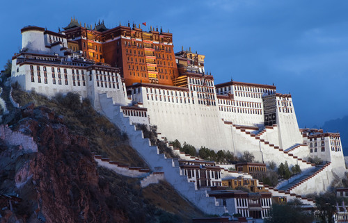 """Tibet's renowned Potala Palace rests high atop """"Red Hill,"""" holding over 1,000 rooms, 10,000 ..."""