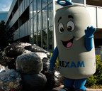 "The Rexam Can Man poses with bags of aluminum cans that were collected for recycling at the company's recent ""Cans for Cash"" event. (PRNewsFoto/Rexam)"