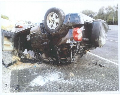 Rebecca Forkey's 2002 Jeep Liberty after she went up an embankment, flipped several times and came to rest upside down on the freeway.