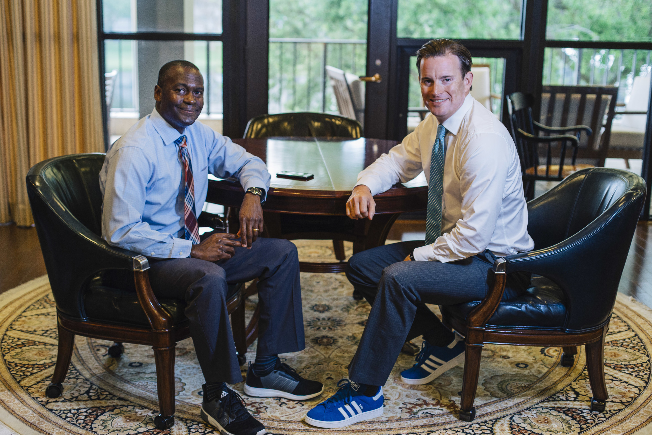 Lynn Athletics Director Devin Crosby and President Kevin M. Ross sign a $1 million deal with adidas.