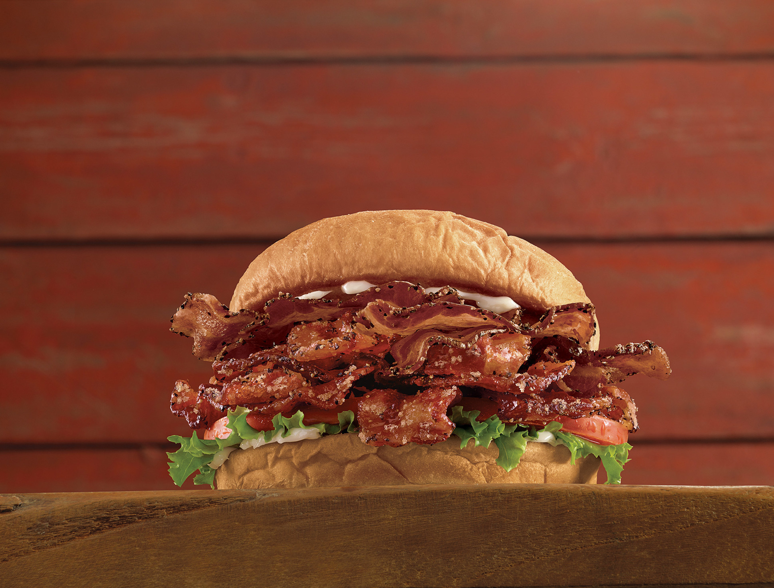 Brown Sugar Bacon BLT: six half strips of brown sugar bacon, six half strips of pepper bacon, lettuce, tomato and mayo on a sweet, fluffy King's Hawaiian bun.