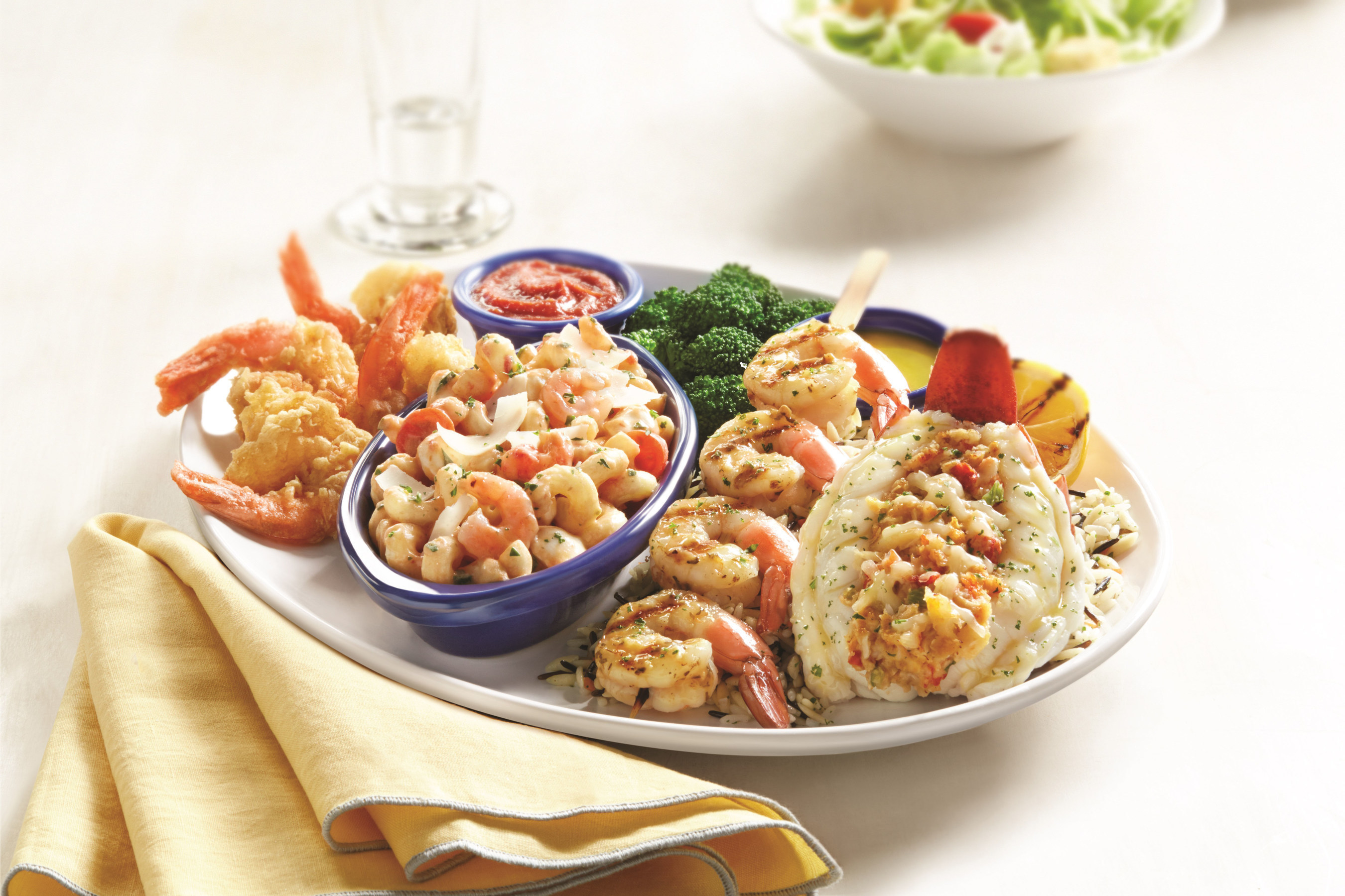 Red Lobster's new Lobster and Shrimp Overboard(TM) pairs a roasted and stuffed Maine lobster tail with a garlic-grilled jumbo shrimp skewer, Langostino Lobster and Shrimp Caprese Pasta and hand-battered jumbo shrimp.