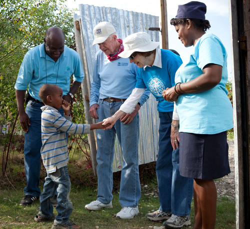 Former U.S. President Jimmy Carter and his wife, Rosalynn, tour completed homes in Habitat's Santo community built during the 2011 Jimmy and Rosalynn Carter Work Project.     (PRNewsFoto/Habitat for Humanity International)
