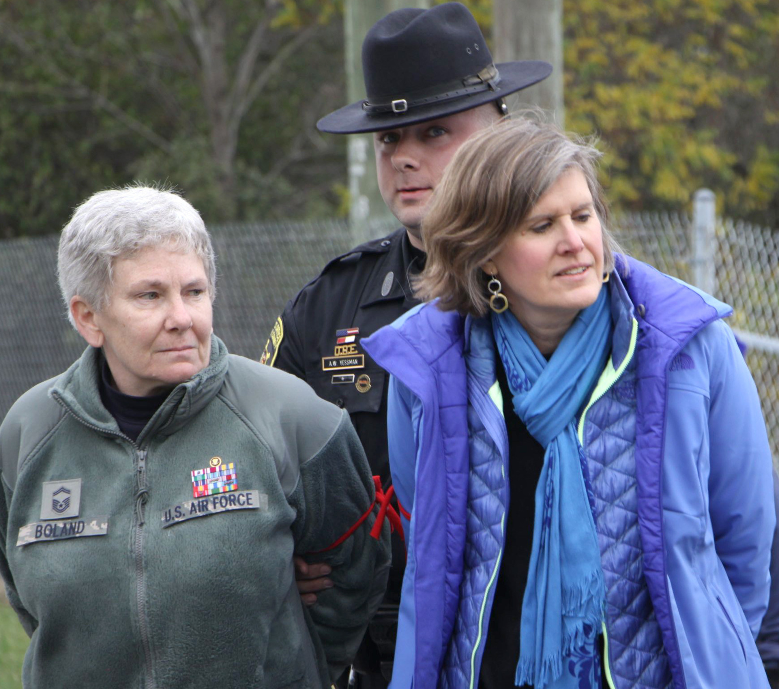 Seneca Lake Defenders Colleen Boland, Senior Master Sergeant, U.S. Air Force (Retired) and renown author and biologist Sandra Steingraber being arrested and led away by Schuyler County Sheriff Yessman. The two women were blockading the gates of Crestwood Midstream with eight others in opposition to expansion of dangerous gas storage in the crumbling salt caverns next to Seneca Lake. It is a center of winemaking and tourism in the pristine Finger Lakes Wine Country.