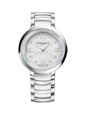 """Embodying the bond between its wearer and one of life's special moments, this polished steel 34 mm-diameter watch features an oval bezel highlighted by the shimmering iridescence of the natural white mother-of-pearl from which it is carved. Worn on a polished steel bracelet whose links echo the curve of the case, this Promesse showcases takes on festive accents by adorning its silver-colored dial and """"drape guilloche"""" decor with Roman numerals and 8 diamond-set indexes. For more information, visit www.baume-et-mercier.com"""