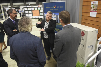 Senior Vice President, LG Air Conditioning Systems, Kevin McNamara, left, and LG Regional Sales Engineer Don Troupe showcase an energy efficient LG HVAC system to visitors at Greenbuild International Conference & Expo on Wednesday, Nov. 18, 2015 in Washington. (Kevin Wolf/AP Images for LG Electronics)