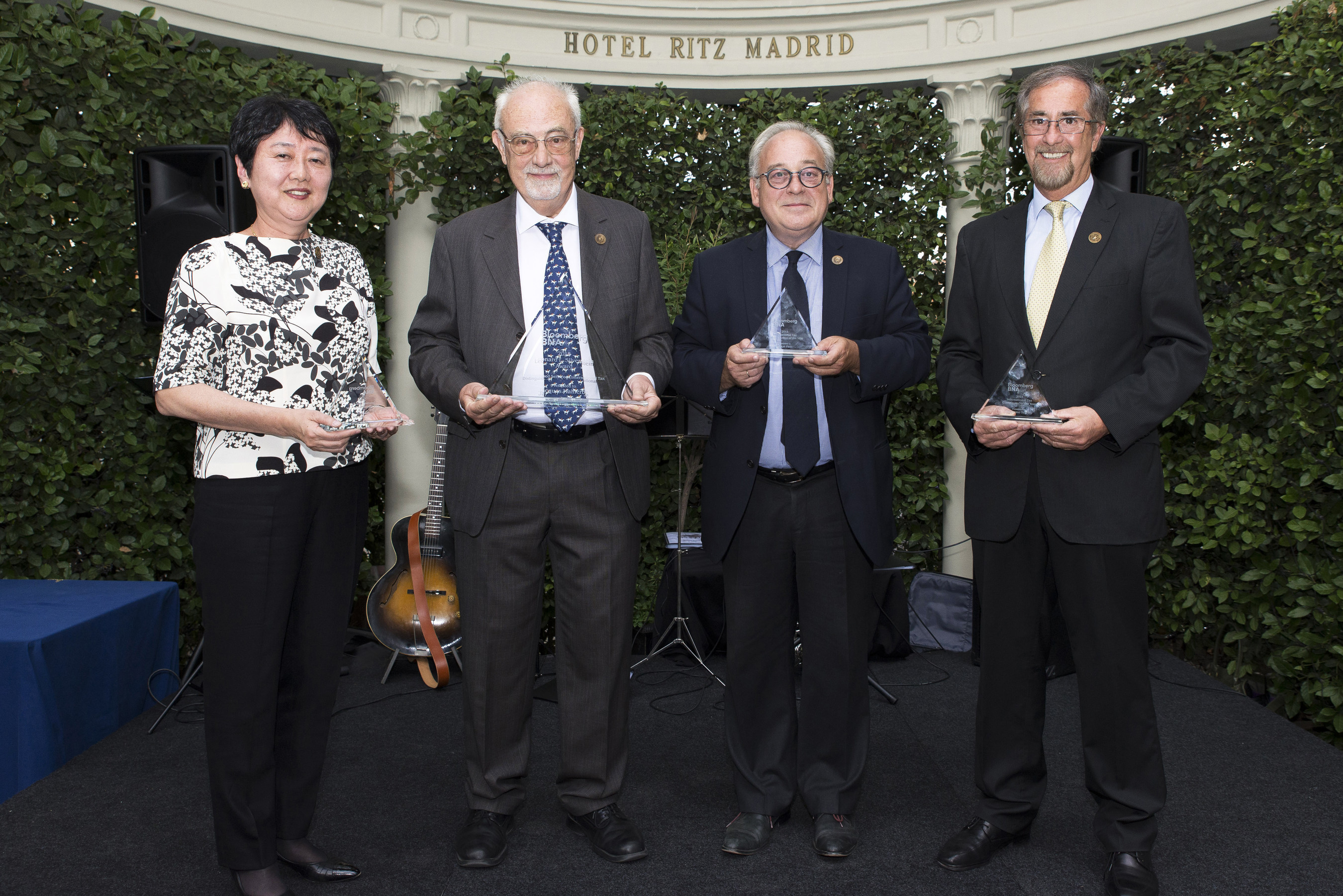 Bloomberg BNA 2015 International Tax Award Recipients: Yuko Miyazaki, Jacques Malherbe, Pascal Faes, and Guillermo Teijeiro (left to right).