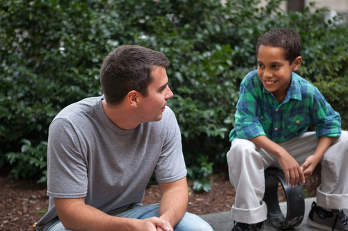 "Edwin, right, hangs out with Big Brother, Brendan, on the set of a video shoot for Big Brothers Big Sisters of Massachusetts Bay's new ""Chicks Dig Bigs"" campaign, which asks women to help find Big Brothers for the 800 boys in Massachusetts Bay who are currently waiting for a mentor. Encourage someone you know to become a Big Brother at bbbsmb.org/ChicksDigBigs.  (PRNewsFoto/Big Brothers Big Sisters of Massachusetts Bay)"