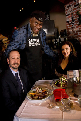Comedian George Wallace serves up some laughs and meals at 15th anniversary of Grape Street Cafe in Las Vegas. Tips benefit Operation School Bell. Wallace performs Tuesday-Saturday at the Flamingo Las Vegas. From left, Artemus W. Ham, George Wallace and Elizabeth Ham. (Photo Jeferson Applegate).  (PRNewsFoto/SCM)