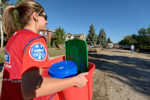 Lowe's Heroes distributed hundreds of relief buckets filled with cleaning supplies to local families in Longmont and Lyons, Colo.  (PRNewsFoto/Lowe's)