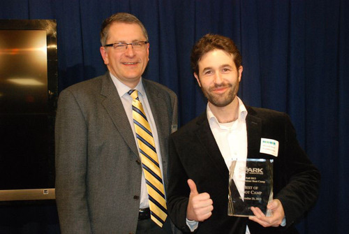 Michael Kaye, PlanReaction founder and CEO, accepts Ann Arbor SPARK Best of Boot Camp award. (PRNewsFoto/Ann ...