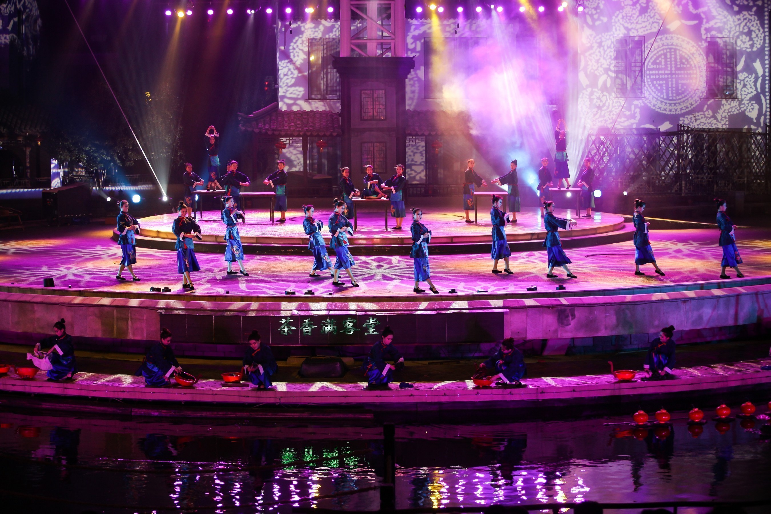 Tourists Immersed in the Live Performance 'Zhouzhuang in Four Seasons' in April with Local Residents