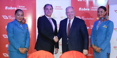 Roy Kinnear, Chief Executive Officer of Air Seychelles, shakes hands with Shane Batt, Senior Vice President, Strategic Clients, Sabre