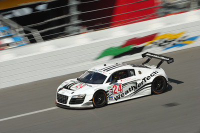 The No.24 Audi R8 in action at the Daytona International Speedway in preparation for this weekend's Rolex 24 at Daytona.  (PRNewsFoto/Alex Job Racing)