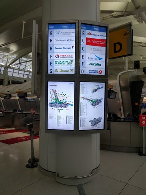 New FIDs (flight information display) in 4 screen display style, retrofitted to one of 8 columns in the terminal.   Parabit designed and installed a total solution for Terminal One Group at JFK, including the enclosures as well as FIDs digital signage. Parabit installed 28 screens total.