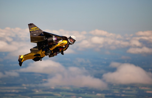 "Yves ""Jetman"" Rossy flies over EAA AirVenture Oshkosh. Photo by Mike Shore, courtesy of Breitling SA.  ..."