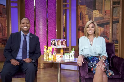 Wendy Williams with Dark and Lovely celebrity hairstylist Mezei Jefferson, who unveiled the hottest summer fashion and styles for naturally curly hair using Dark and Lovely Au Naturale and Dark and Lovely Fade Resist Rich Conditioning Color on The Wendy Williams Show.