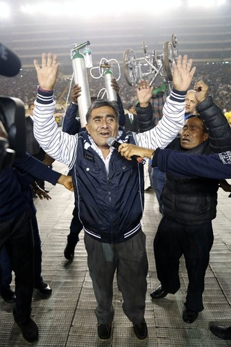 A man happily waves his hands after receiving healing from difficulty in breathing and walking. (PRNewsFoto/Emmanuel TV)