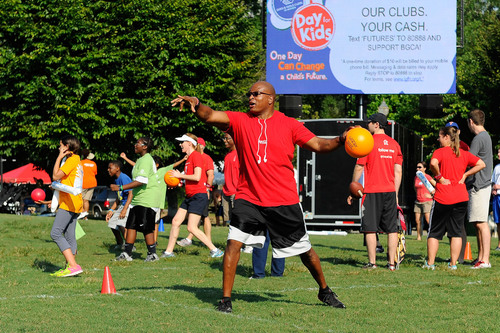 Teams participate in dodgeball during a field day event in Atlanta on Saturday, September 7, to kick-off Boys &  ...