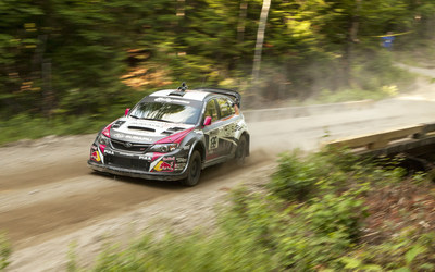The #199 car of Travis Pastrana and Chrissie Beavis claimed 5 rally stage wins and 2nd place overall behind teammate David Higgins. (PRNewsFoto/Subaru of America, Inc.)
