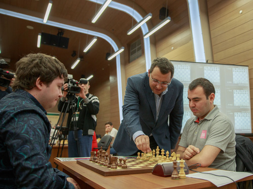 World Rapid Chess Champion Shakhriyar Mamedyarov watches as Khanty-Mansyisk mayor Vasili Filipenko opens the tournament by making the first move. Rapid and Blitz chess championship took place in Khanty-Mansyisk, Russia in June 2013.  (PRNewsFoto/Chess News Agency)