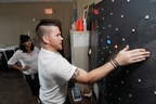 USMC Sgt. Travis Buskuhl participates in visuomotor and cognitive assessment training using the Dynavision in the SHARE Military Initiative. (Photo by Gary Meek)