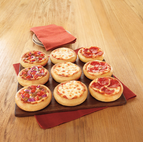THE SECRET IS OUT: PIZZA HUT UNVEILS BIG PIZZA SLIDERS AS LATEST INNOVATION, GIVES CUSTOMERS A CHANCE TO TRY ONE FREE. (PRNewsFoto/Pizza Hut) (PRNewsFoto/PIZZA HUT)