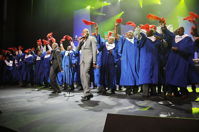 Myron Butler (l) and Donnie McClurkin perform with the NFL Players Choir at the 12th Annual Super Bowl Gospel Celebration at Music Hall in Dallas, TX.  (PRNewsFoto/Super Bowl Gospel Celebration)
