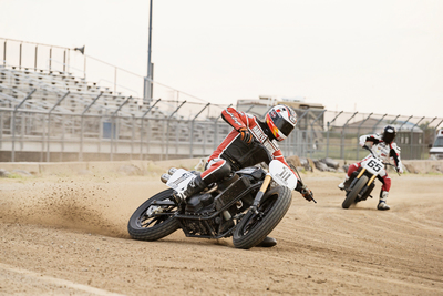 "A Harley-Davidson Street(TM) 750 prototype race motorcycle - ridden by AMA Pro Flat Track Grand National Champion, Brad ""the Bullet"" Baker - sends dirt flying during an exhibition Flat Track race leading into X Games Austin and just weeks before the new bike hits U.S. dealerships. Fans get to decide if Flat Track racing will become an X Games medal event in 2015 via #XGamesFlatTrack. (PRNewsFoto/Harley-Davidson Motor Company)"