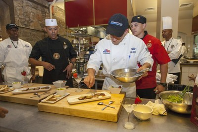Senior Airman Caleb Cejka puts the finishing touches on his team's recipe challenge dish at the 2016 Armed Forces Forum for Culinary Excellence, hosted at The Culinary Institute of America at Greystone, in California.
