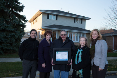 Silver Certificate and $1,750 Awarded to Chicago Couple for Improved Home Performance.Pictured, left to right: Ken Marx, Director, Green Energy Improvement; Alderman Mary O'Conner, City of Chicago 41st Ward; George Bohling, Award Recipient Homeowner; Gail Bohling, Award Recipient Homeowner; Grace Lunsford, Owner, Green Dream Group.  (PRNewsFoto/Green Energy Improvement)