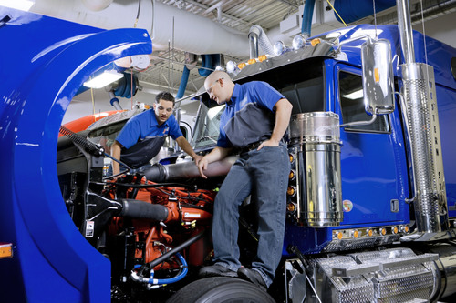 """""""Finish First"""" students work on a Freightliner truck in the UTI-Avondale Diesel Lab.  ..."""