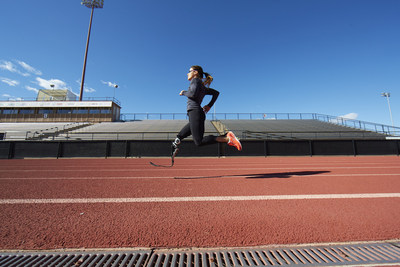 Lacey J. Henderson trains on the athletics track.
