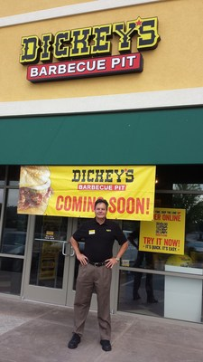 Larry Hoffmeister outside his first Dickey's Barbecue Pit in the Bridge Street Town Centre. Three day grand opening kicks off Thursday. (PRNewsFoto/Dickey's Barbecue)