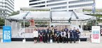 Volunteers from the New Orleans Chapter of Second Harvest Food Bank all pose by the world's largest Carnival cruise ship made out of cans, sponsored by Carnival Cruise Line near Poydras Street side of the Mercedes-Benz Superdome in New Orleans on Monday, December 21, 2015.  (Photo by Peter G. Forest)
