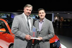 Dave Zuchowski, president and CEO, Hyundai Motor America receives the Edmunds.com Top Rated Vehicle award for the 2015 Sonata from Scott Oldham, editor in chief, Edmunds.com.