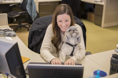 Mars Petcare Associate Desiree Hove sends some emails with a helping paw from her pup. While Friday, June 24 is International Take Your Dog to Work Day, the Franklin, Tenn.-based company welcomes its 4-legged Associates year-round.