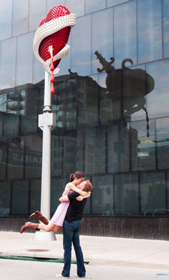 A Denver couple embraces in front of the MCA Denver.  (PRNewsFoto/VISIT DENVER, The Convention & Visitors Bureau, Casey Wigotow)