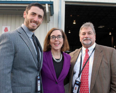 Josh Matheson, Vice President of Operations (left) and Charles Mellor, Chief Operating Officer for Matheson Trucking, Inc., with Oregon Governor Kate Brown at the launch of air cargo service between Portland and Asian markets on November 4, 2016.  Matheson Flight Extenders is handling import/export freight consolidation services for Cathay Pacific Airways at its facility at the Portland International Airport.
