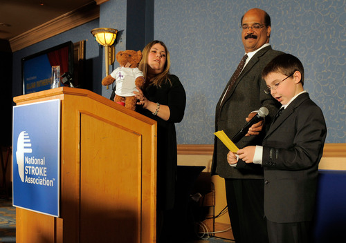 Pediatric stroke survivor Elijah Rutherford, 9, (far right) accepts the Most Creative Raising Awareness in Stroke Excellence (RAISE) Award from stroke survivor, Mark McEwen (right), at National Stroke Association's 2012 RAISE Awards on Oct. 19, 2012, in Denver, Colo.  (PRNewsFoto/National Stroke Association)