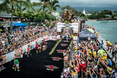 2013 women's champion Mirinda Carfrae crossing the finish line at last year's IRONMAN World Championship. The 2014 IRONMAN World Championship presented by GoPro will take place Saturday, October 11 in Kailua-Kona, Hawai`i. More than 2,000 athletes representing 68 countries and territories on six continents will compete in this year's race, which comprises a 2.4-mile open-water swim, 112 miles of cycling and a 26.2-mile run. (Nils Nilsen/IRONMAN) (PRNewsFoto/IRONMAN)