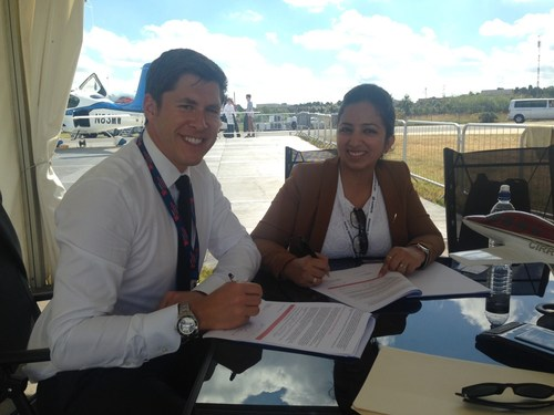 Adam Hahn, Director of Sales for Cirrus Aircraft; and Roohi Bali, Sales Manager for Cirrus India. ...