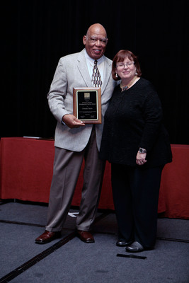 Dr. Orlando Taylor of The Chicago School of Professional Psychology receives the National Communication Association's 2011 Samuel L. Becker Distinguished Service Award from Immediate Past President of NCA, Dr. Lynn H. Turner.  (PRNewsFoto/The Chicago School of Professional Psychology)