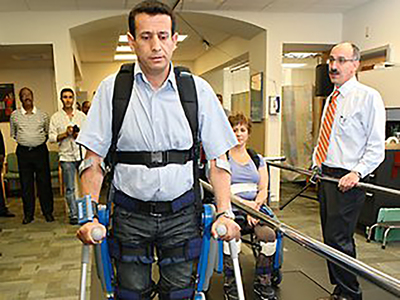 Fattah observes a ReWalk demonstration at MossRehab in 2009 (PRNewsFoto/Office of Congressman Fatta)