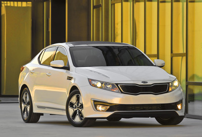 Kia Motors America's first hybrid vehicle in the U.S. will begin arriving in showrooms in June with a starting price of $26,500.  (PRNewsFoto/Kia Motors America)