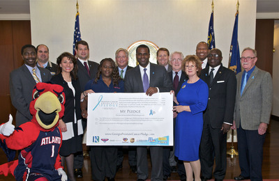 Pictured from left to right: Harry the Hawk, Dr. Roland Mathews (Morehouse School of Medicine), Damon Aluisy (SB), Shelly Glenn (RC Cancer Centers), Mike Krachon (Bard), Twanda Black  (Kiss 104.1), Bob Williams (President, Atlanta Hawks) Mayor Kasim Reed, Alan Wills (Georgia Cancer Coalition) Tom McCleary (Georgia Prostate Cancer Coalition), Margaret Murphy (RC Cancer Centers), Dr. M. Rony Francois (Director, Division of Public Health), Virgil Fludd (State Representative) and Ken Stevens (Georgia Prostate Cancer Coalition).   (PRNewsFoto/The Georgia Prostate Cancer Pledge Committee)