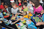 Christmas comes early for families stationed at Guantanamo Bay Naval Base, Cuba during the Toy Industry Foundation and Boys and Girls Clubs of America Military Services toy distribution on Saturday, December 4th.  (PRNewsFoto/The Toy Industry Foundation)