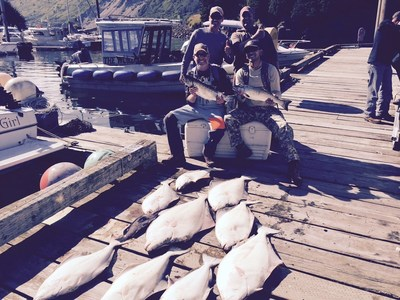 Wounded Warrior Project Alumni show off part of their catch while at 10th Annual Kodiak Fishing Trip
