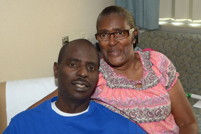 May 7, 2013: Alfred Williams, the first patient in the Gulf South Region to receive the SynCardia Total Artificial Heart, with his mother Rebecca Williams at Ochsner Medical Center in New Orleans.  (PRNewsFoto/SynCardia Systems, Inc.)