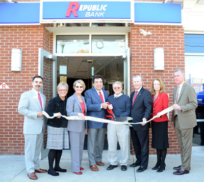 On November 2, Republic First Bancorp, Inc. (NASDAQ: FRBK), the holding company for Republic Bank, opened a new store in Media, Pa., located at the intersection of East Baltimore Pike and Route 252 (New Providence Road). The photograph features (L to R): Tony Cavaliere, Media Store Manager, Republic Bank; Bonnie Scarborough, Co-director, Media Food Bank; Rhonda S. Costello, Executive Vice President and Chief Retail Officer, Republic Bank; Harry D. Madonna, Chairman and Chief Executive Officer, Republic Bank; Bob McMahon, Mayor, Media; Andrew J. Logue, President and Chief Operating Officer, Republic Bank; Sharon Hammel, Senior Vice President and Senior Retail Market.  (PRNewsFoto/Republic First Bancorp, Inc.)